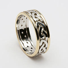 ID117 Passion - Ladies, This classic Celtic knot represents eternal love; the knot intertwines with itself leaving neither beginning nor end. 14ct Yellow and white gold.